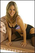 Melanie Walsh in gorgeous purple and black lingerie and stockings